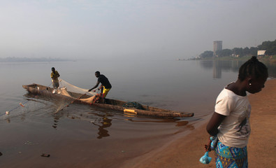 People fish in the Oubangui river, close to the capital Bangui