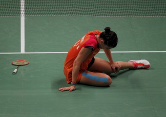 Spain's Carolina Marin reacts after injuring her foot during her women's singles badminton match with Taiwan's Pai Yu-po at the BWF World Championship in Jakarta, Indonesia