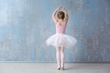 Cute little ballerina in dance studio