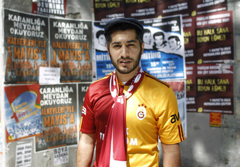 Soccer fan Arslan wearing Galatasaray jersey poses during a May Day rally in Istanbul