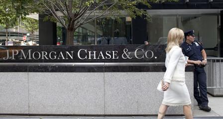 A woman walks past JPMorgan Chase & Co's international headquarters on Park Avenue in New York