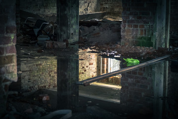 The view from an old, abandoned factory in inside with nice reflection and window light
