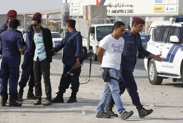 Riot police arrest human rights activists Yousif al-Mahafdhah and Naji Fateel during their march towards al-Eker village in Sitra