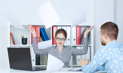 Director in a rage throws documents brought to the signature of the employee.