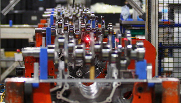 Ford Motor's 3500 Duramax engines are checked by a laser as they move along the assembly line at the Ford Lima Engine Plant in Lima