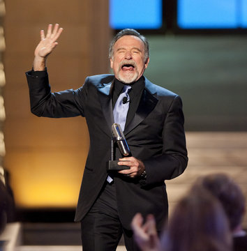 Comedian Robin Williams reacts after receiving the Stand Up Icon Award during the second annual 2012 Comedy Awards in New York