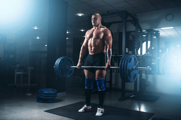 Strong athlete exercise with weight in fit gym