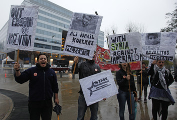 Demonstrators protest over the presence of Turkish Prime Minister Tayyip Erdogan in Buenos Aires