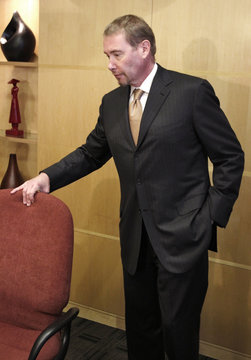 Superstar bond fund manager Gundlach, whose collections of art, pricey watches and fine wine were recently plundered by burglars, arrives for a news conference in Los Angeles