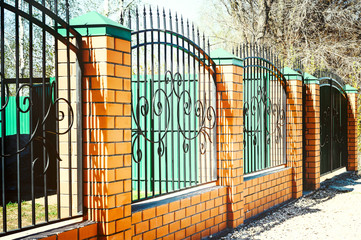 Brick and Metal Fence with Door and Gate of Modern Style Design Metal Fence Ideas.