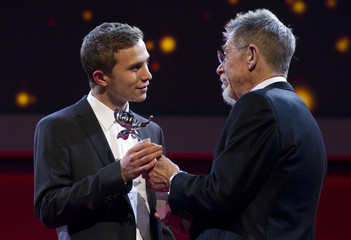 British actor Hurt awards Swiss actor Hubacher Shooting Star award at Berlinale International Film Festival in Berlin