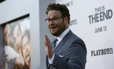 """Rogen waves at the premiere of """"This Is the End"""" at the Regency Village Theatre in Los Angeles"""