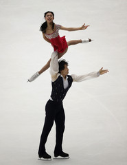 China's Pang Qing and Tong Jian perform at the pairs free skating programme during ISU Grand Prix of Figure Skating in Beijing