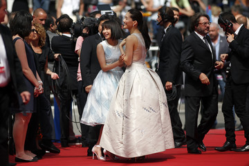 "Cast members Suzu Hirose and Haruka Ayase pose on the red carpet as they arrive for the screening of the film ""Our Little Sister"" during the 68th Cannes Film Festival in Cannes"