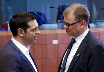 Greece's PM Tsipras talks to his Finnish counterpart Juha Sipila during an EU-CELAC Latin America summit in Brussels