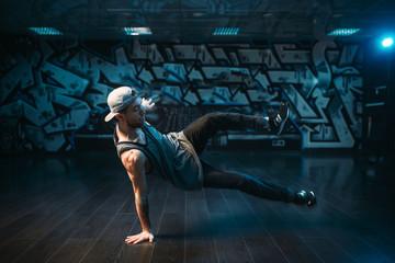 Young breakdance performer dancing in studio