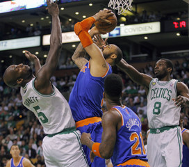 Celtics' Garnett guards Knicks' Chandler during the first half of Game 6 of their NBA Eastern Conference semifinal playoff basketball series in Boston