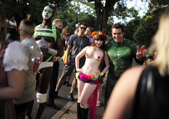 Participants in the 2015 Sydney Gay and Lesbian Mardi Gras parade pose for a photo as they wait to use a portable toilet