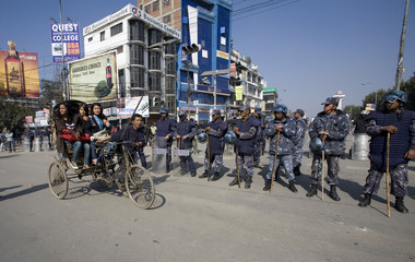 Commuters take a rickshaw during the general strike in Kathmandu