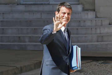 French Prime Minister Manuel Valls waves as he leaves the cabinet meeting at the Elysee Palace in Paris