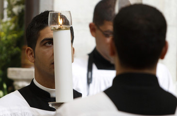 A Catholic priest takes part in the Christmas Mass at the Church of the Nativity in the West Bank city of Bethlehem