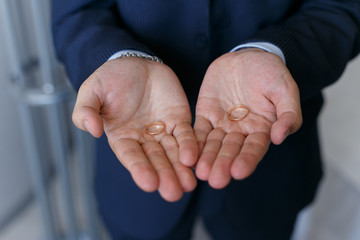 Two wedding rings on a hands of the groom