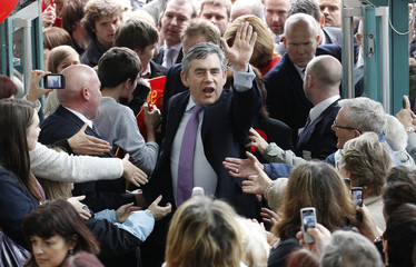 Britain's Prime Minister Gordon Brown waves to supporters in Skelmersdale