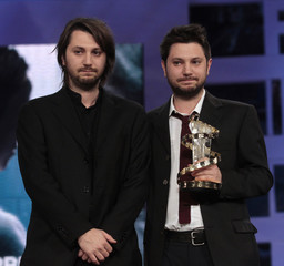 """Twin brothers Gianluca and Massimiliano De Serio of Italy win the Jury Award for Best Director for the film """"Sette opere di misericordia"""" at the Marrakech 11th FIFM closing ceremony"""