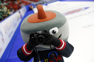 Slider the curling mascot takes a photo with a photographer's camera before the start of the bronze medal game between Team Canada and Saskatchewan during the Scotties Tournament of Hearts in Moose Jaw