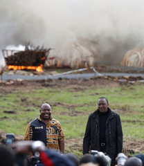 Kenya's President Kenyatta and Gabon's President Ondimba pose for a photograph after lighting an estimated 105 tonnes of Elephant tusks confiscated ivory from smugglers and poachers at the Nairobi National Park near Nairobi, Kenya