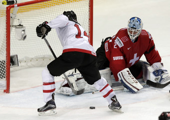 Canada's Eberle scores against Switzerland's goaltender Berra during their Ice Hockey World Championship game at the O2 arena in Prague