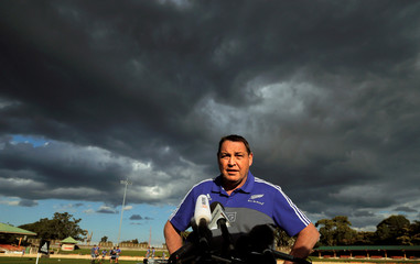 The New Zealand All Blacks rugby team coach Steve Hansen speaks to the press under cloudy skies during a team training session in Sydney