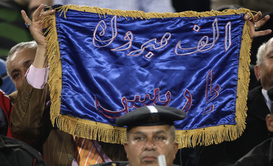 Al Ahly fans cheer with a banner for President Hosni Mubarak during the soccer match against El Zamalek during their Egyptian Premier League derby soccer match at Cairo Stadium