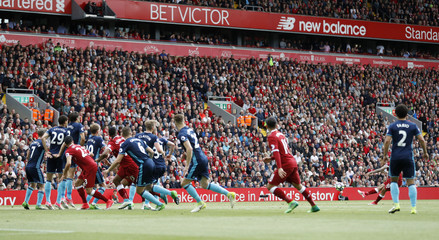 Liverpool's Philippe Coutinho scores their second goal from a free kick