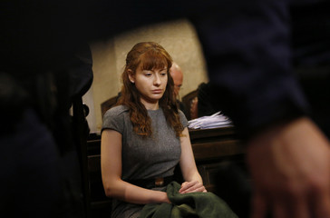 Carranza sits in a courtroom on the last day of her trial in Vienna