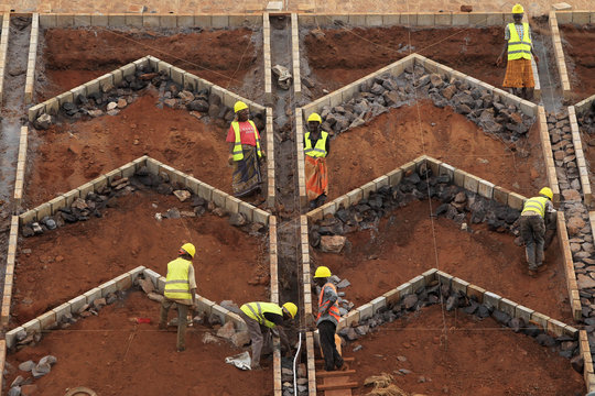 Construction workers work at a landscaping section of the Mombasa-Nairobi standard gauge railway near Emali