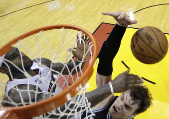 Heat's LeBron James stops Spurs center Tiago Splitter from dunking during Game 2 of the NBA Finals in Miami