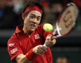 Japan's Nishikori returns a shot against Canada's Polansky during their Davis Cup world group first round tennis match in Tokyo
