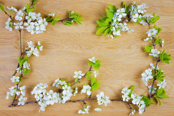 Spring flowers. Apple flowers on wooden background. Flat lay, top view