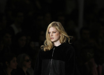 A model presents a creation by fashion designer White Tent as part of his women's Autumn/winter 2012 fashion collection during Lisbon Fashion Week