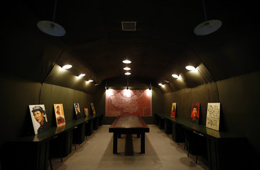 A room decorated with military maps and old propaganda posters can be seen in a cave that was once the headquarters of former Chinese Communist military leader Lin Biao, located in mountains on the outskirts of Beijing