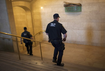 MTA policemen descend onto the closed lower lever of New York's Grand Central Terminal