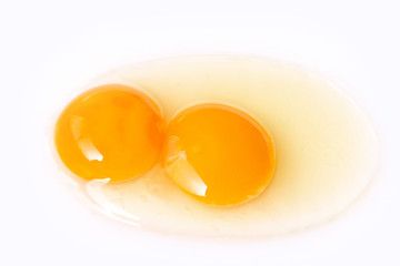 Fresh egg twins on white background, ready for the cooking.