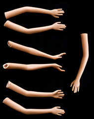 Broken Doll Arms and Hands on Black Background