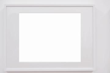 Closeup horizontal blank white frame on white wall, decoration idea