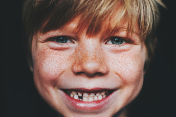 Portrait of a gap toothed smiling boy