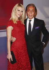 Actress Danes and Italian fashion designer Valentino arrive at a party to celebrate the opening of a virtual museum dedicated to him, in New York