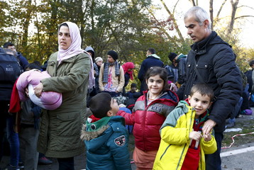 Syrian migrants Khalil arrives with wife and children at the Austrian-German border in Achleiten near Passau