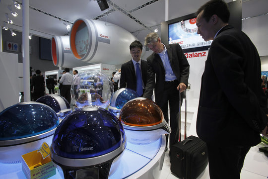 German visitor looks at a Galanz microwave oven at Canton Fair in Guangzhou