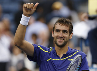 Cilic of Croatia celebrates after defeating Klizman of Slovakia in their men's singles match at the U.S. Open tennis tournament in New York